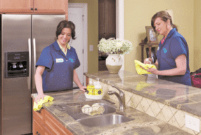 Two Maid Right team members cleaning a kitchen counter