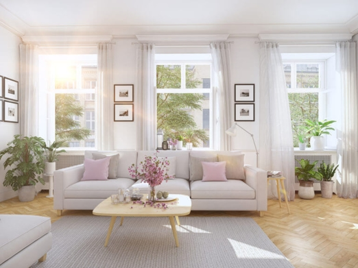 Living room with white couch and pink and grey accents