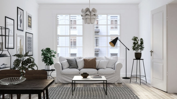 Living room with a white couch and neutral accent pieces