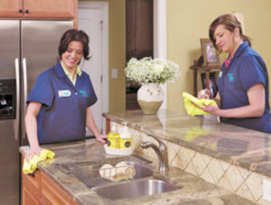 two maids cleaning a kitchen