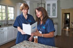 Two maids going over a cleaning checklist for quality cleaning services in Short Pump