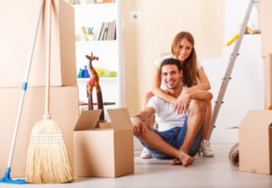 Happy couple moving in new home with the help of our moving cleaning services in Sugar Land